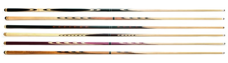 Billiard cue sticks on a white back drop