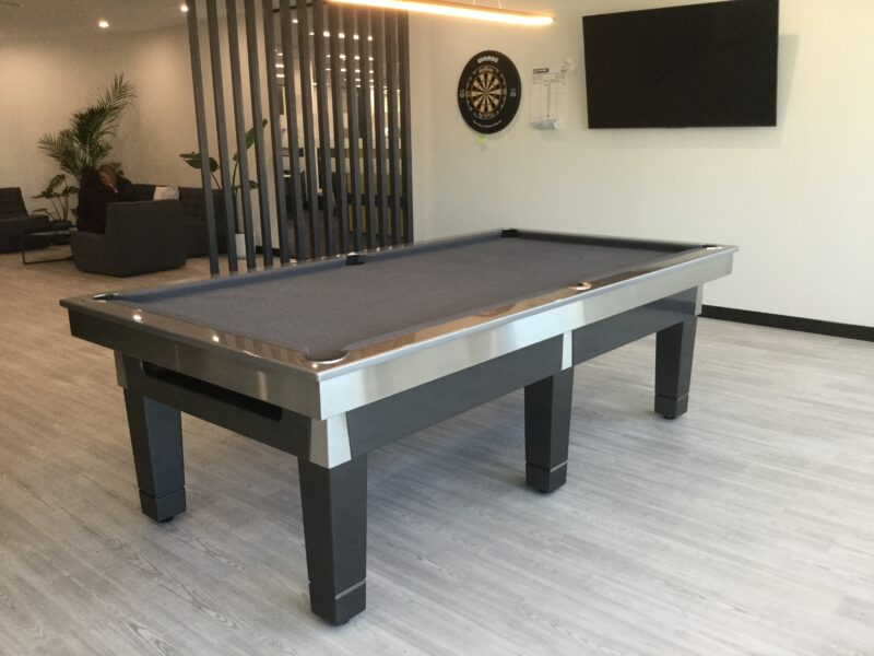 A pool table, tv and dart board for a corporate recreation room.