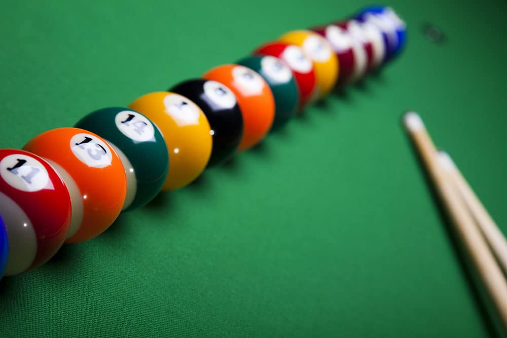 lined up pool balls on a table