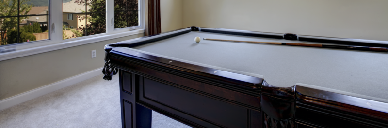 A classic old pool table displayed in a games room in all it's glory.