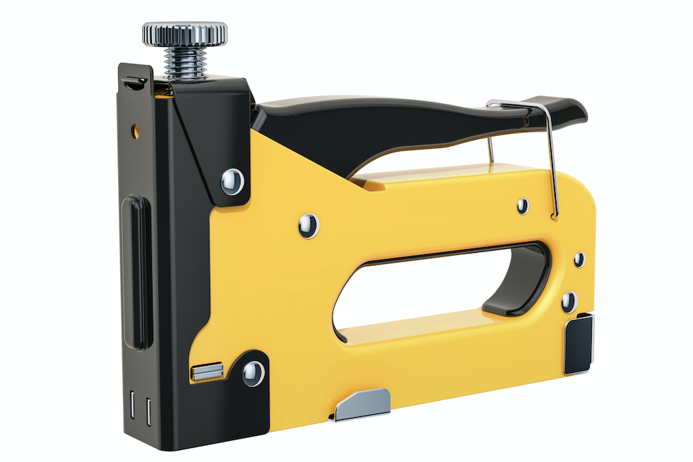 Yellow staple gun used for pool table felt.