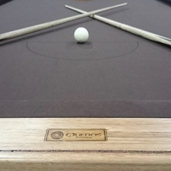 Brown felt on a rustic pool table created by Quedos.