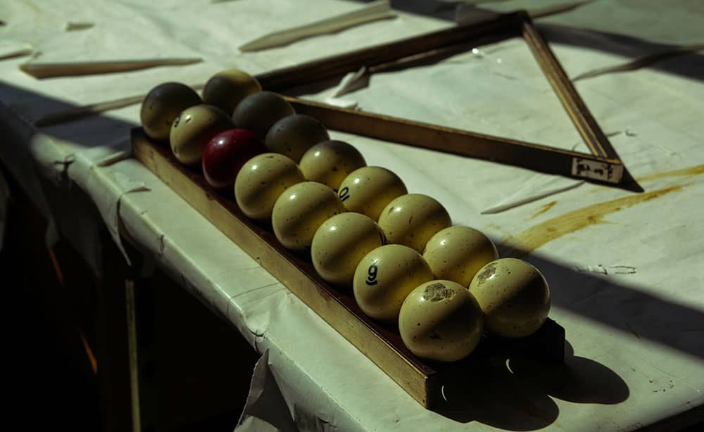 vintage pool balls on antique table
