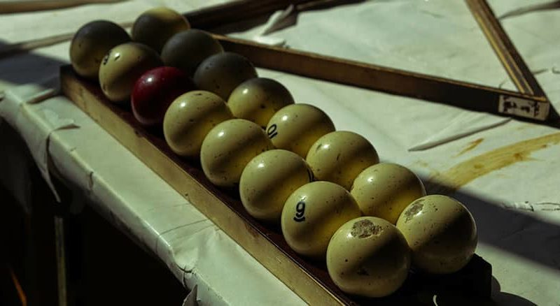 Antique pool balls on a vintage table